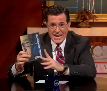 Stephen Colbert holds up Charles River Media Group Photography